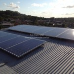Afternoon reflection on new rooftop solar installation