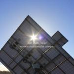 Sun shining through solar tracker